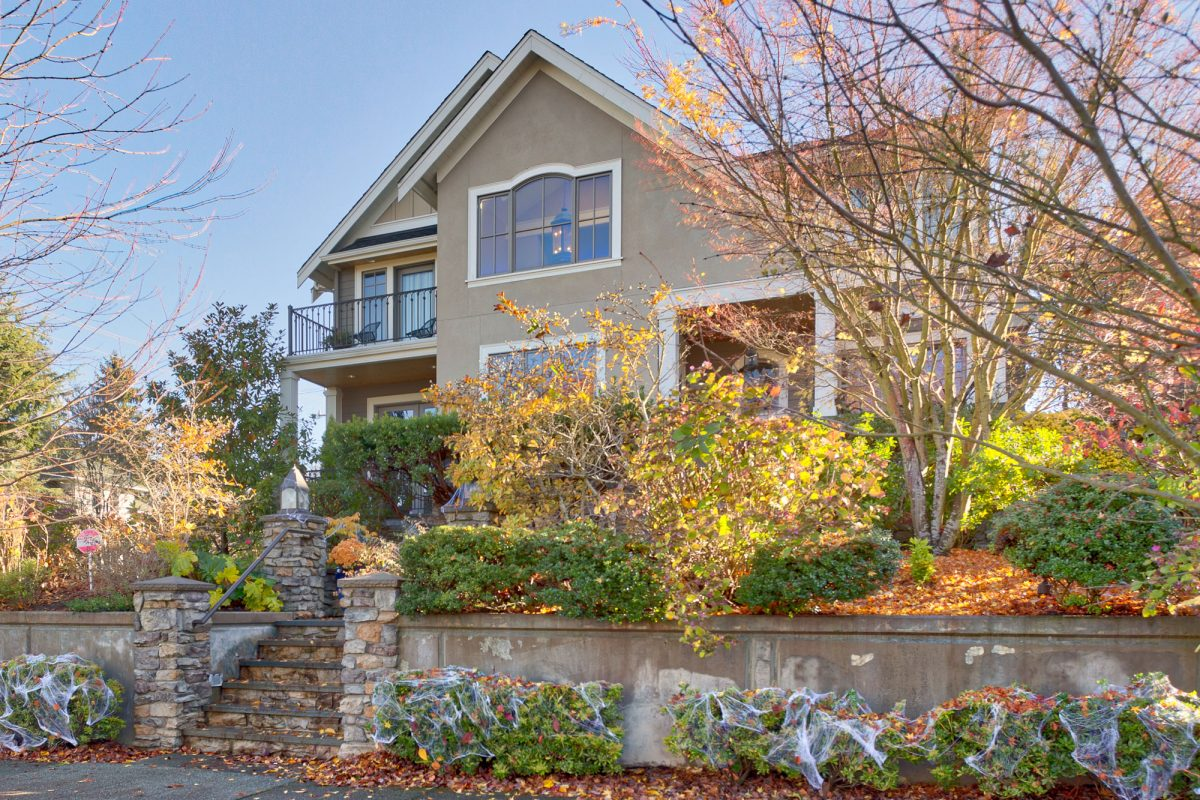 A street view of a new, large home created by Exterior Crew, LLC in Seattle, WA