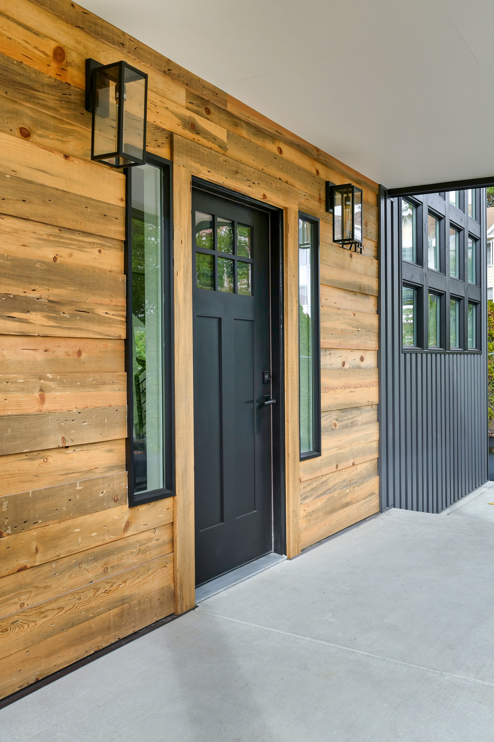 Reclaimed wood front entry and metal siding